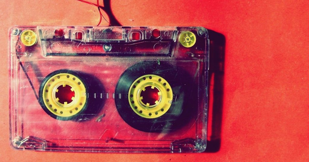 old cassette with tape out on beautiful background