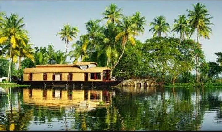 houseboat floating in a lake in kerala