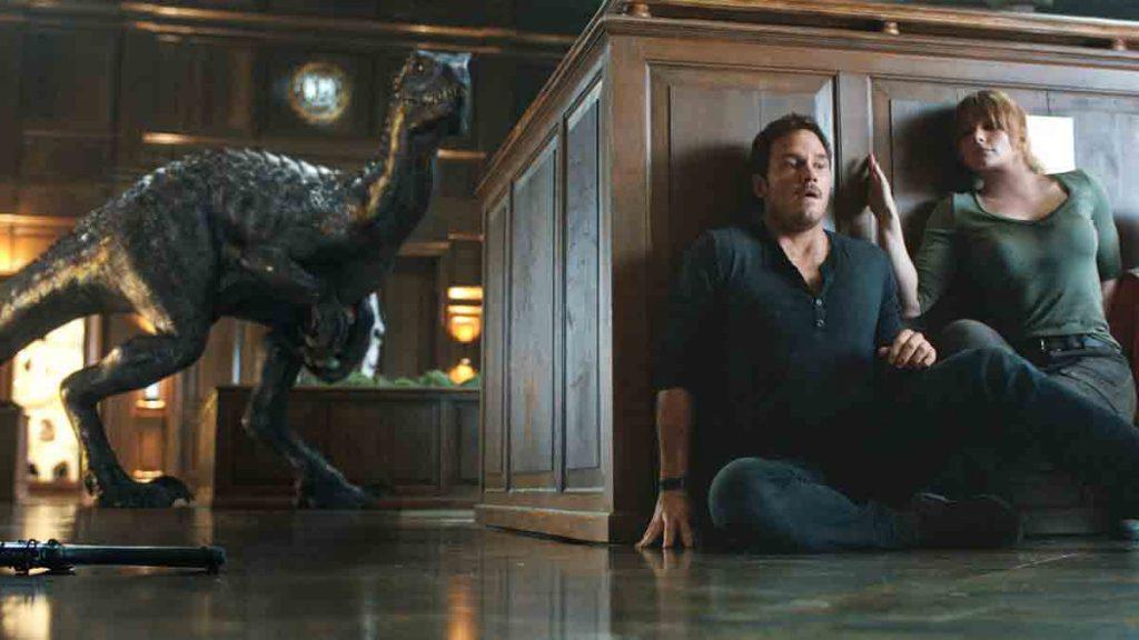Jurassic World Fallen Kingdom scene of a man hiding from dinosaurs