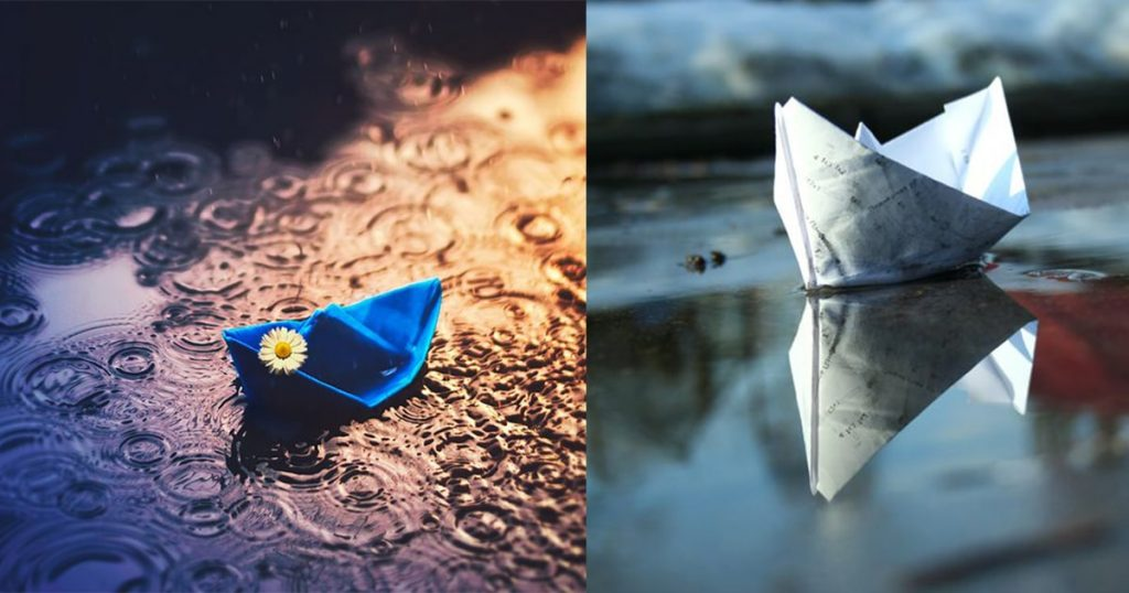 paper boats floating in water during rain