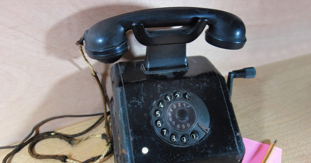 old telephone with revolving numbers on a table