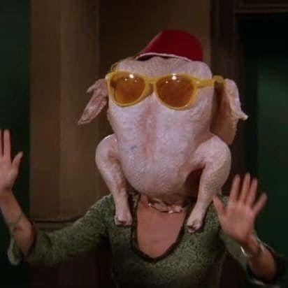 monica wearing the turkey on her head