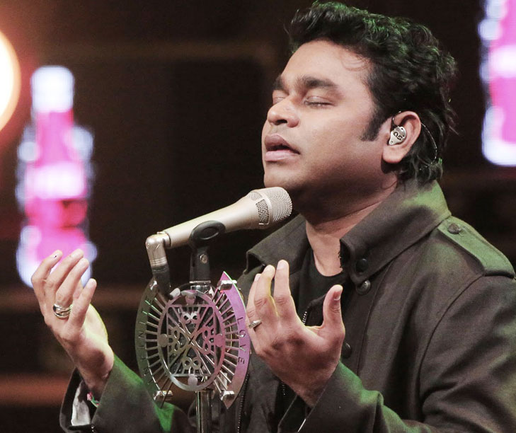 a r rahman singing in a show