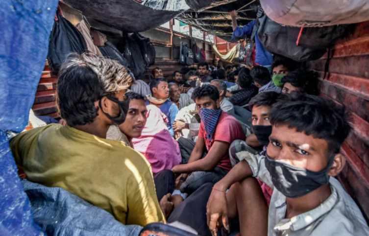 migrants in a truck amid lockdown