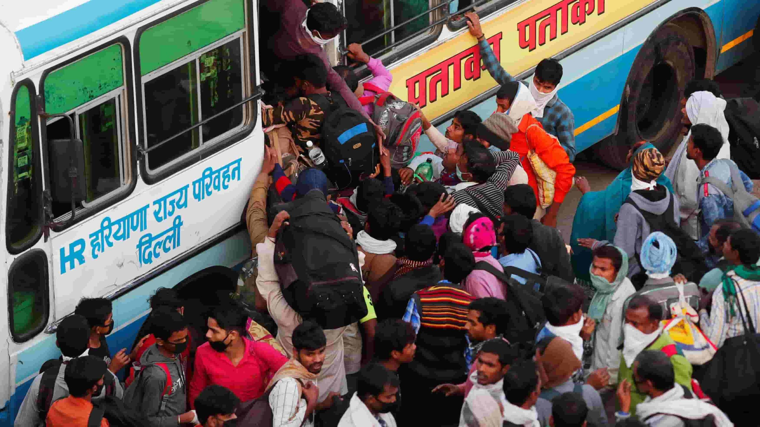 boarding bus in india and not following social distance