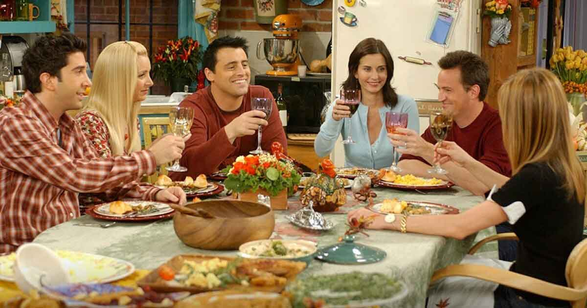 friends cast members having thanksgiving dinner together