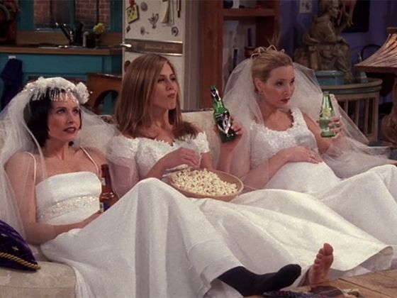 friends girls chilling in their bridal dresses