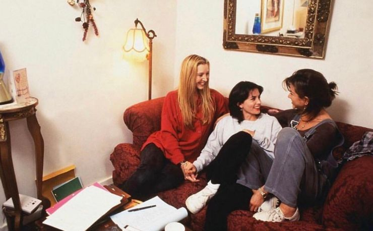 three girls from friends enjoying in a room while reading script