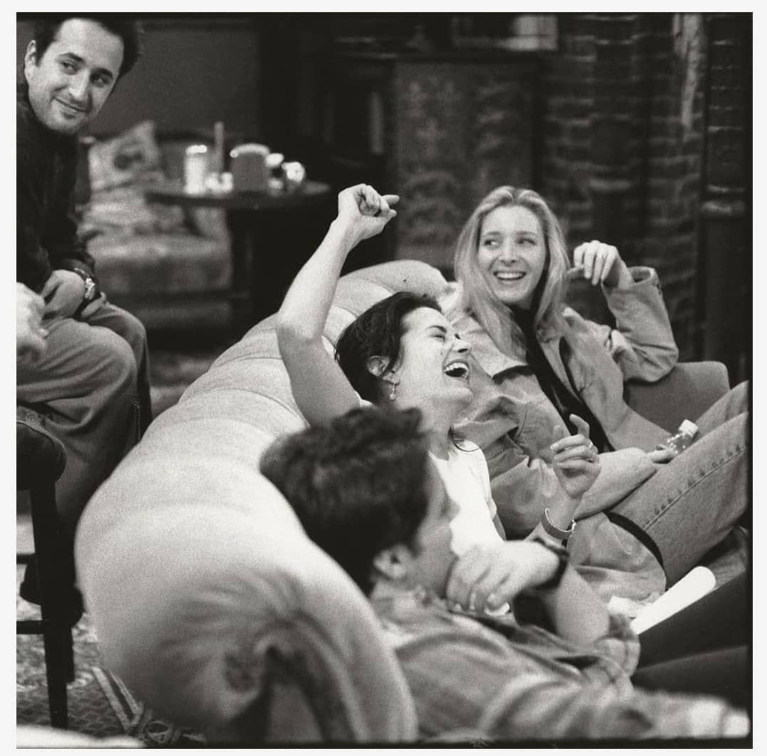 friends cast like monica and barry laughing while just before shoot begin
