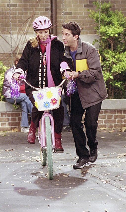 ross gifted a cycle to phoebe and then taught her to ride it