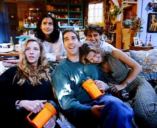 friends cast laughing and enjoying backstage photo
