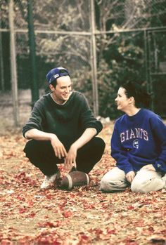 monica and chandler chilling out in friends sets while playing football