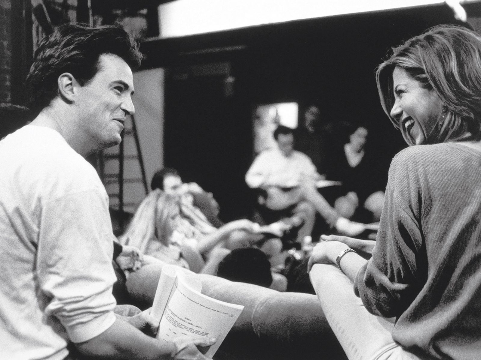 chandler and rachel looking happy while shooting