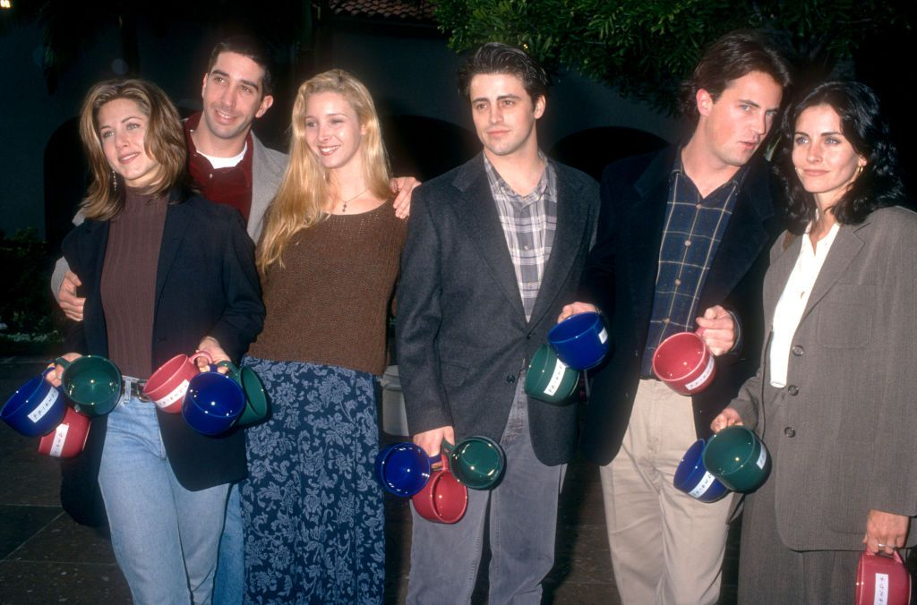 friends cast unseen picture holding coffee mugs in a photoshoot