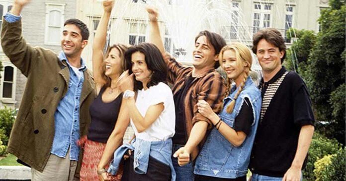 chandler bing looking away in group photo of friends