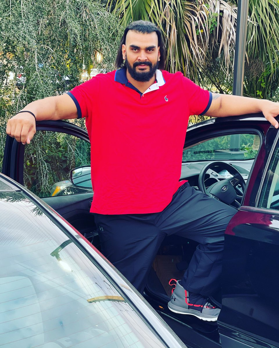 Giant Zanjeer Indian wrestler with a car