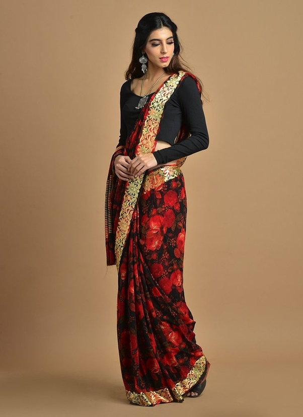 colour contrast saree with a complimenting background