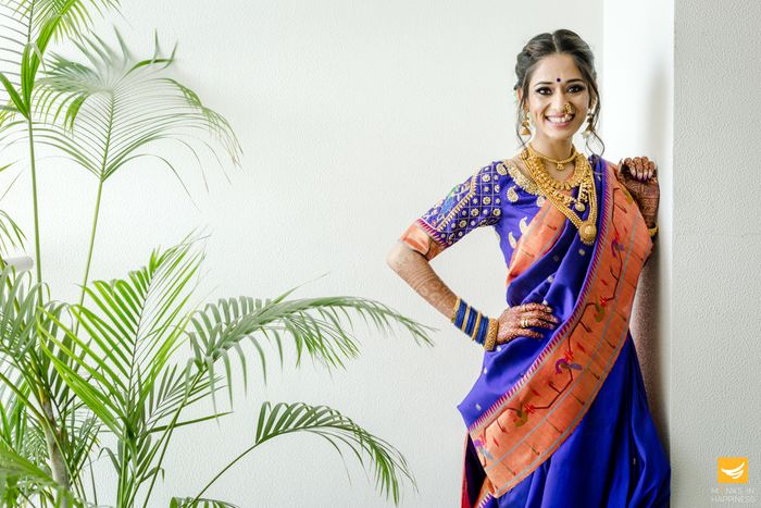 photoshoot while wearing blue saree in a light background