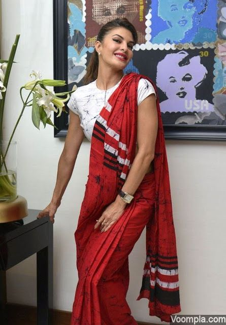 bending down saree poses for next photo session