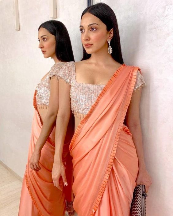 posing with saree infront of a mirror