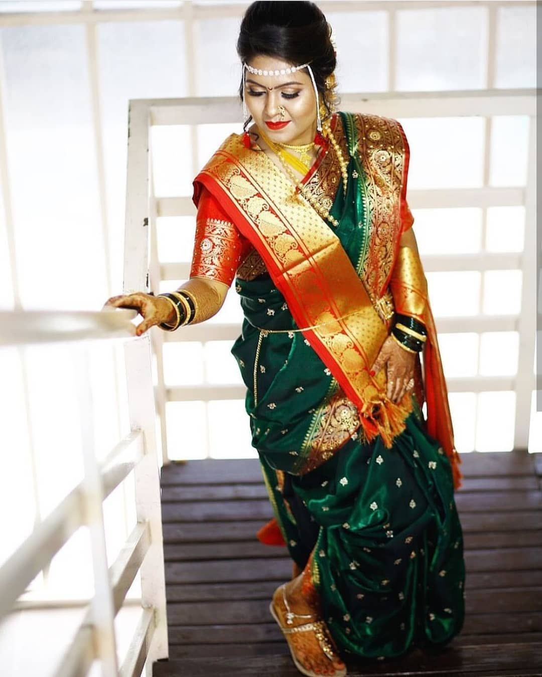 posing on the stairs with a traditional saree