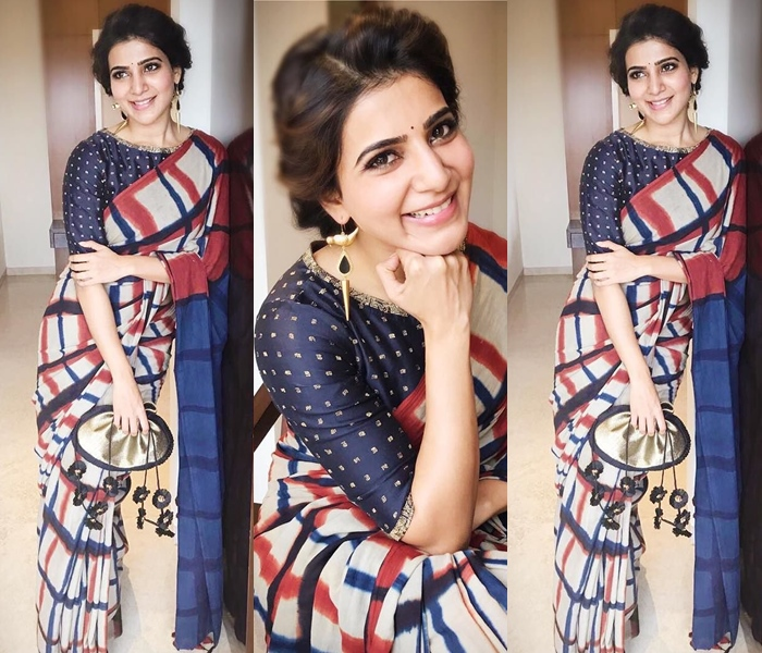 traditional saree pose while leaning to the wall