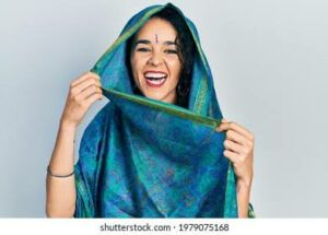 saree poses with a beautiful smile.