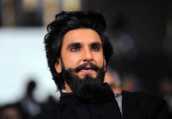 Ranveer Singh in black suit with long hair