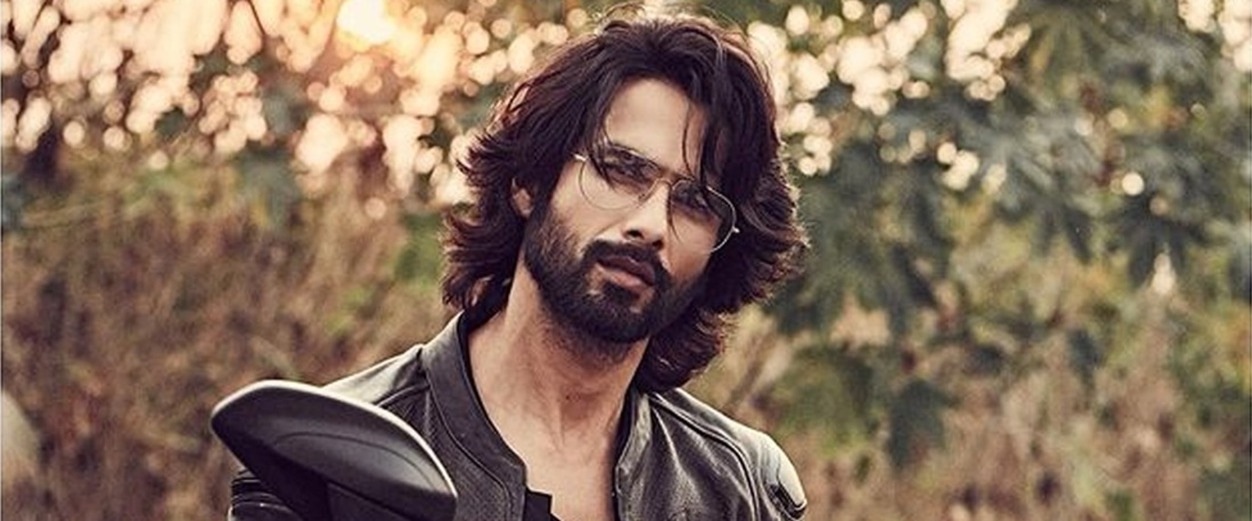 Shahid kapoor in fringed hairstyle while posing with bike
