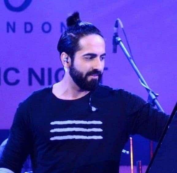 ayushmann khurran in man bun in a concert