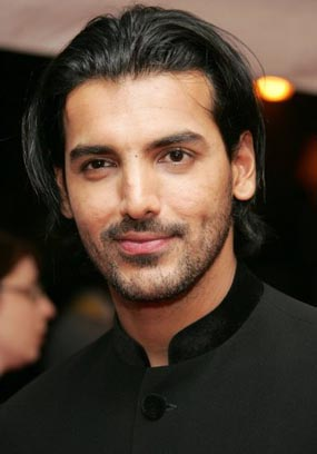 john abraham in black suit with long hair