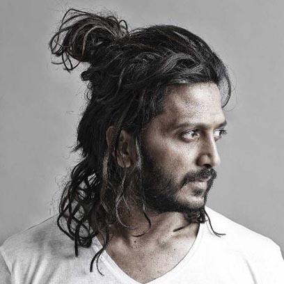 ritesh deshmukh in messy bun hairstyle