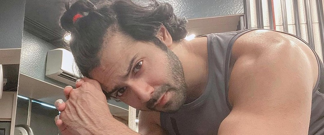 varun dhawan in half ponytail while working out